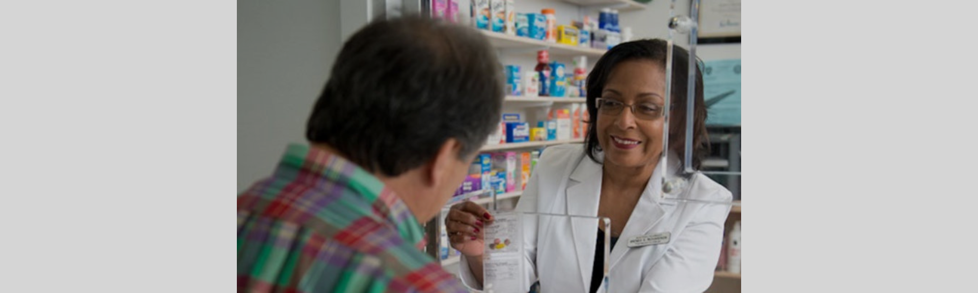 female pharmacist with customer
