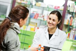 Pharmacist is talking to the customer